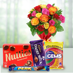 Crunchy mixed Cadburys Chocolate with charming Roses to Thane