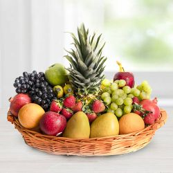Delicious Seasonal Fruits basket gift hamper to Hassan