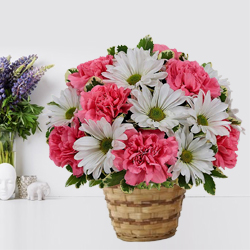 Lovely colorful Flower arrangement in a Bamboo Pot to Thane
