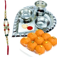 Laddoo and Stylish and Trendy looking Silver Plated Paan Shaped Puja Aarti Thali along Rakhi, Roli, Tilak and Chawal