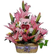 Bright Artificial Flowers with Teddy in a Basket