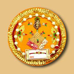 Beautiful Divine Rakhi N Traditional Thali Combo