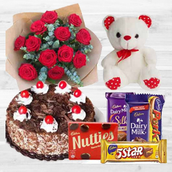 Pleasant Bouquet of 12 Dutch Red Roses with 1 Lb Cake, Mixed Cadburys Chocolates and a Teddy Bear