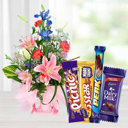 Send Charming seasonal Flowers with mouth-watering mixed Cadburys Chocolate to Pollachi