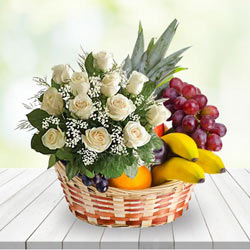Touching Basket	of Fresh Fruits with Whi