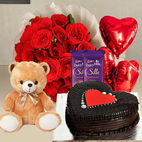 Elegant Red Roses, Chocolate Cake, Mylar Balloons, Chocolates and a Teddy