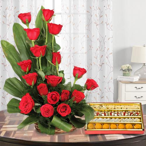 Haldirams Assorted Sweets with Red Roses Arrangement