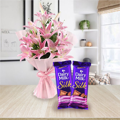 Order Combo Gift of Dairy Milk Silk and Pink Lilies Bouquet Online