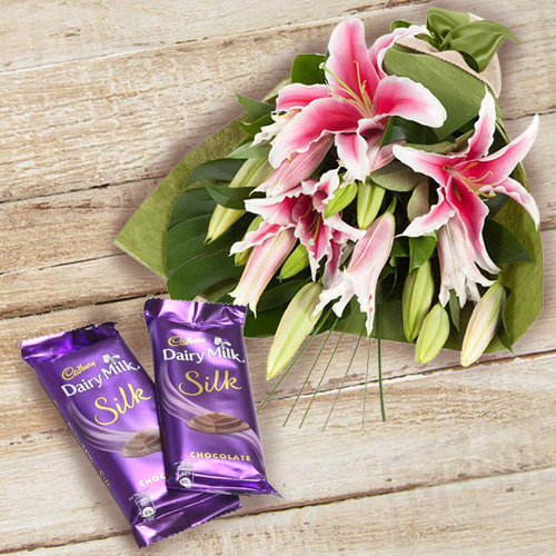 Order Online Dairy Milk Silk and Pink Lilies Bouquet Online