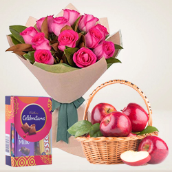 Tangy Bunch of Pink Roses with Dairy Milk Celebration and Apples Basket