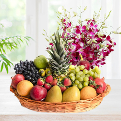 Fanciful Gift of Orchids Bunch with Top-Quality Fruits Basket