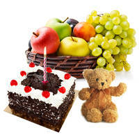 Top-Quality Fruits Basket N Mouth-watering Black Forest Cake with Teddy N Candles
