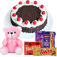 Lavish 1 Lb Black Forest Cake with Assorted Cadburys Chocolate and a Small Teddy