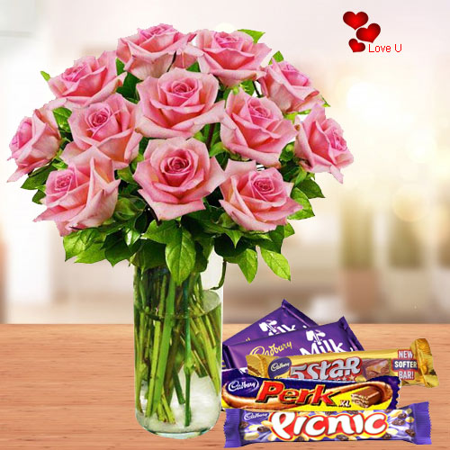 Buy Assorted Chocolates with Pink Roses in a Vase for Rose Day