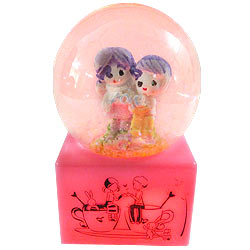 Romantic Love Couple with Floating Tinsel in a LED Lighted Glass Globe