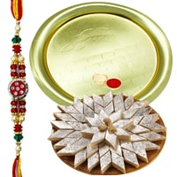 Auspicious Gift of Glorious German Silver Golden Plated Thali along with Crunchy Kaju Katli of 100 Gms from Haldirams