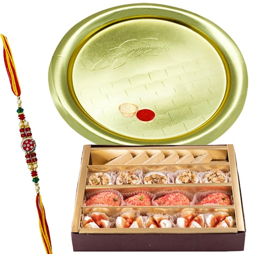 Assorted Sweets and Silver Plated Puja Thali along Rakhi, Roli, Tilak and Chawal