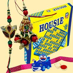 Incomparable Housie Deluxe Family Board Game with Rakhi, Lumba, Doraemon Rakhi and Roli, Tilak and Chawal.