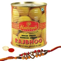 One or More Designer Ethnic Rakhi with 1 Kg. Haldirams Rajbhog Pack