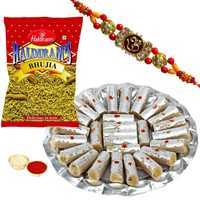 One or More Designer Ethnic Rakhi with 500 Gms. Kaju Pista Roll n 200 Gms. Haldirams Bhujia